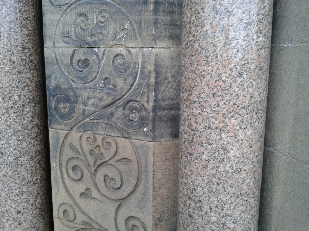 Polished granite and carved sandstone at main entrance.