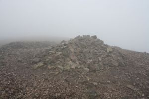 Carnethy summit cairn in cloud