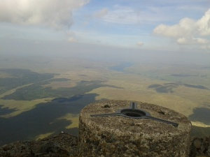 Trig point overlooking lower ground from Cullin Ridge, Skye