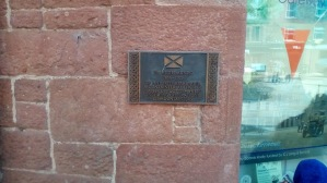 Wee plaque on wall