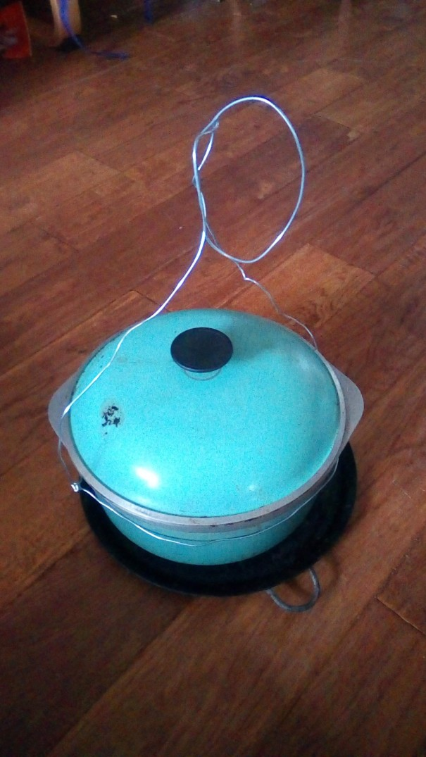 Dutch oven with new lid knob and bail arm.