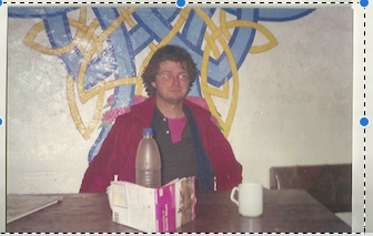 Geezer in front of the mural at Craig